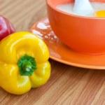 Rice porridge with egg in orange bowl. — Stock Photo #19008403