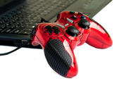 Red joystick game controller on laptop . — Stock Photo