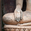 Closeup of hand buddha statue in Sukhothai historical park, — Stock Photo