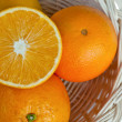 Stock Photo: Orange fruit on basket.