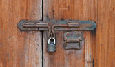 Closed wood door with lock — Stock Photo