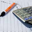 Calculator on paper  graph . — Stock Photo