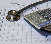 Stethoscope on medical graph and calculator. — Stock Photo