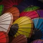 Hand made color paper umbrellas. — Stock Photo