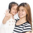 Happy asian little girl with her mother. — Stock Photo #51078653