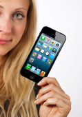 Woman shows new iphone 5 — Stock Photo