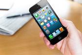 Using Apple iphone 5 — Stock Photo