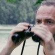 Stock Video: Mwatching nature through binoculars