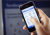 Apple Iphone with Facebook App — Stock Photo