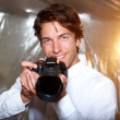 Young handsome photographer — Stock Photo #13889000