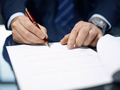 Close up of businessman signing a contract. — Stock Photo