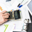 Calculating with business documents - Stock Photo