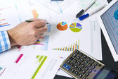 Calculating with business documents — Stock Photo