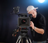 Cameraman working with a cinema camera — Stock Photo