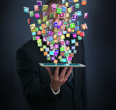 IPad with a cloud of application icons — Stock Photo