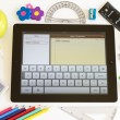 Ipad 3 with Notes application and school accesories — Stock Photo #13770231