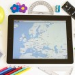 Ipad 3 with maps and school accesories — Stock Photo