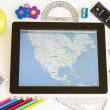 Stock Photo: Ipad 3 with maps and school accesories
