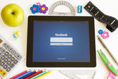 Facebook on Ipad 3 with school accesories — Stock Photo