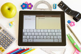 Ipad 3 with Notes application and school accesories — Stock Photo