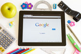 Google on Ipad 3 with school accesories — Stock Photo