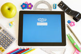 Skype on Ipad 3 with school accesories — Stock Photo