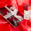 Digital tablet with christmas present — Stock Photo #13970946