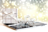 Digital tablet with christmas present — Stock Photo