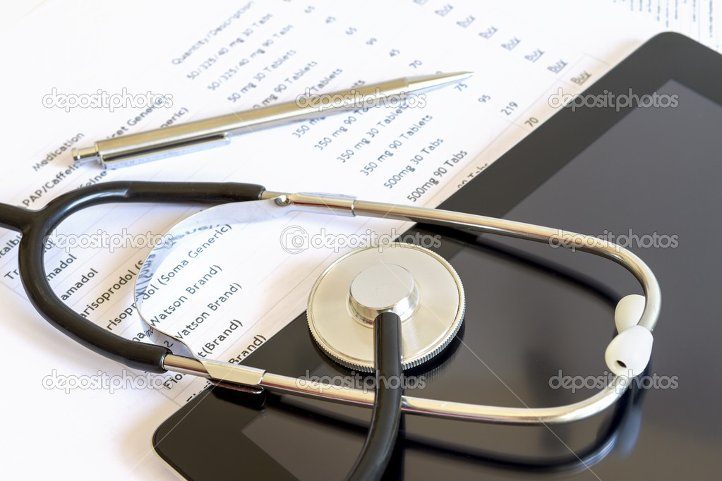 Digital tablet with stethoscope and paperwork — Stock Photo #13970845