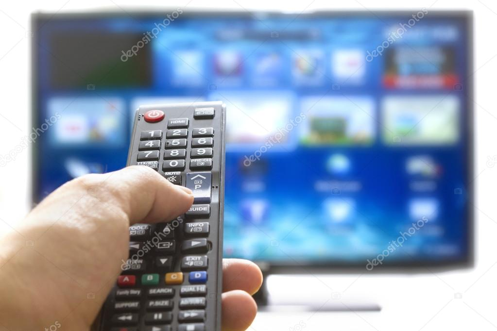 Television remote control changes channels thumb on the blue TV screen  Stock Photo #19562533