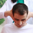 Physiotherapy for adult with cervical problems - Stock Photo