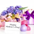 Gift for Mother's Day candies and flowers — Stock Photo