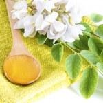 Acacia honey in spoon — Stock Photo