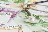Money and stethoscope, medical insurance — Stock Photo
