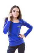 Teenage girl thinking for an answer on smartphone — Stock Photo