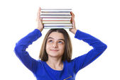 Young girl with stack of books on her head — Stock Photo