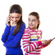 Happy teen girls with digital tablet and smartphone — Stock Photo #40353029