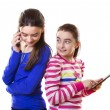 Happy teen girls with digital tablet and smartphone — Stock Photo