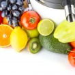 Juicing machine, fresh fruits and vegetables — Stock Photo