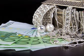 Silver jewelry and Euro — Stock Photo