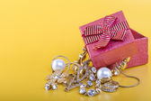 Gold jewelry and gift box — Stock Photo