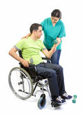 Physical therapist works with patient in lifting hands weights.  — Stock Photo
