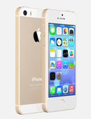 Apple Gold iPhone 5s showing the home screen with iOS7. — Stock Photo
