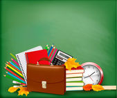 Back to school Green background with school supplies and autumn leaves — Stock Vector