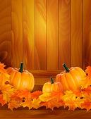 Dynie na drewniane tła z liści jesienią tło wektor — Wektor stockowy