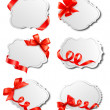 Stock Vector: Set of beautiful cards with red gift bows with ribbons Vector