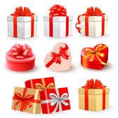 Set di scatole regalo vettore colorato con fiocchi e nastri. — Vettoriale Stock