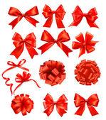 Stor uppsättning röda gåva bågar med band. vektor — Stockvektor