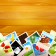Colorful photos on wooden background. Vector illustration. — Stock Vector