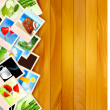 Colorful photos on wooden background. Vector illustration. — Stock Vector #13432585